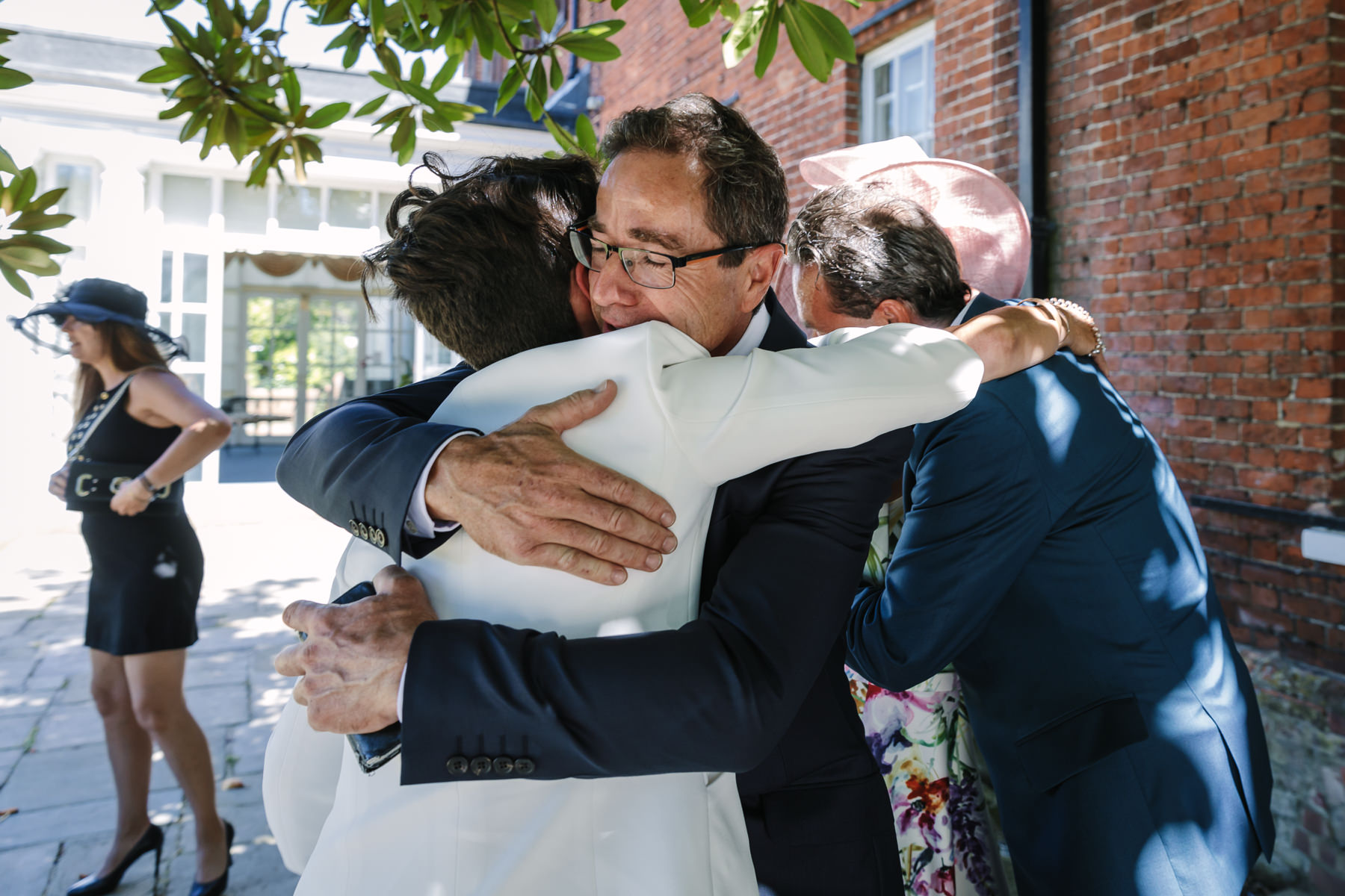 father of the bride embrace emotional moment natural authentic documentary wedding photo bride groom couple beaverbrook surrey hills leatherhead register office wedding photographer