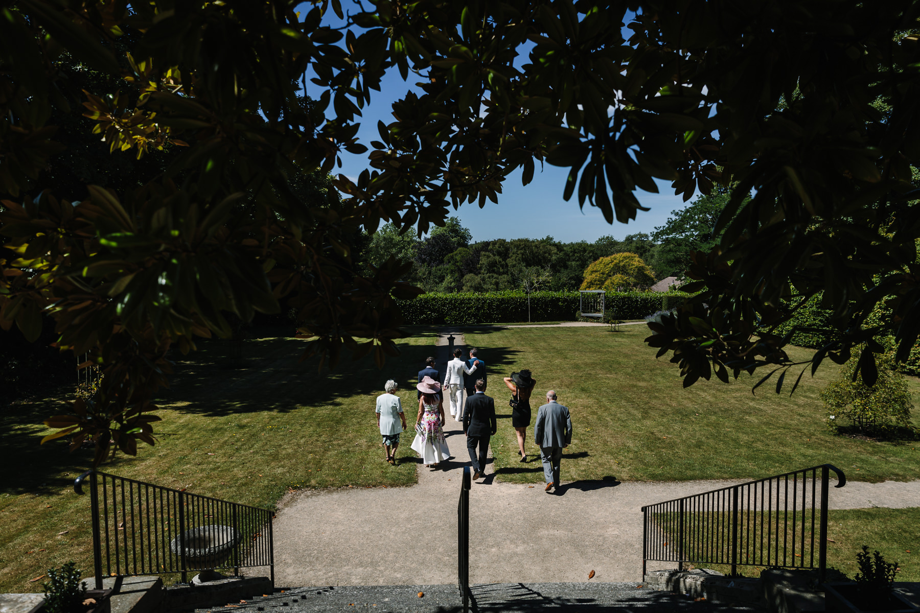 wedding party in leatherhead registry office gardens natural authentic documentary wedding photo bride groom couple beaverbrook surrey hills leatherhead register office wedding photographer