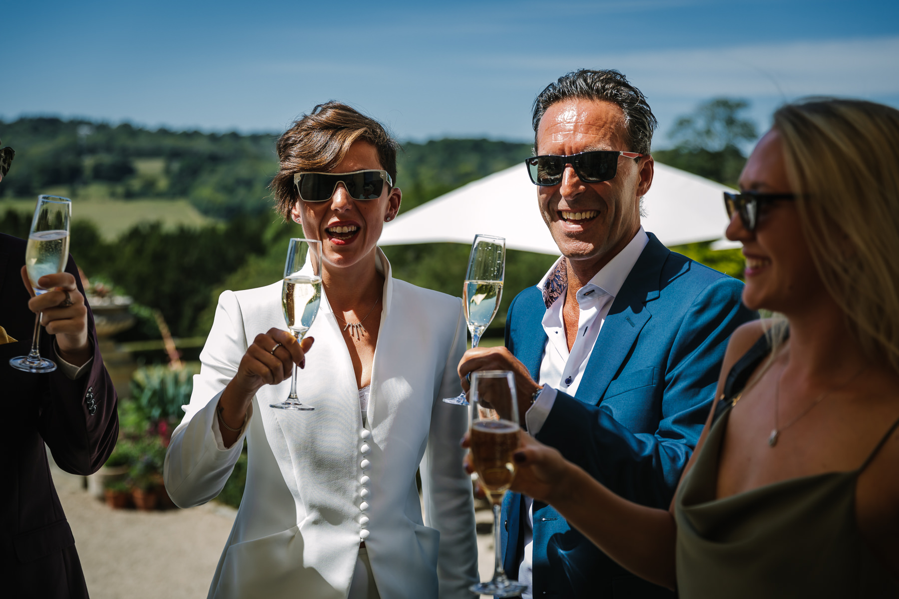 just married toast champagne natural authentic documentary wedding photo bride groom couple beaverbrook surrey hills leatherhead register office wedding photographer