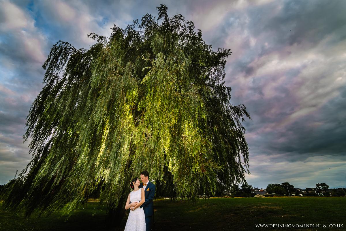 dramatic-sky-off_camera_flash-multi_ethnic-couple-multicultural-wedding-photography-diversity-photographer-bride-groom-portrait-love_is_love-rainbow