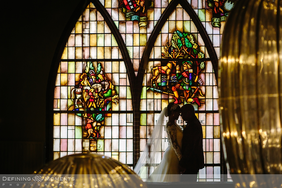surrey documentary wedding photographer documentary natural stylish contemporary wedding photography indoor portrait session bride groom stained glass
