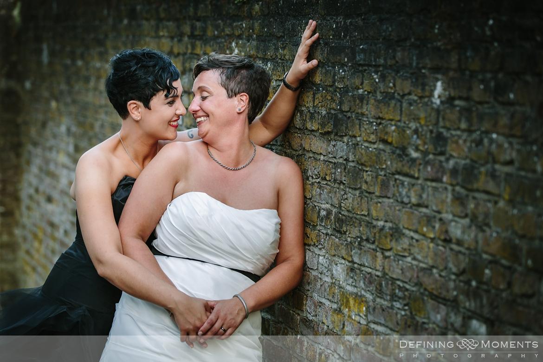 amberley_castle east_sussex de_vere_estate horsley farnham surrey wedding photographer same_sex lesbian gay castle wedding lgbt brides black dress