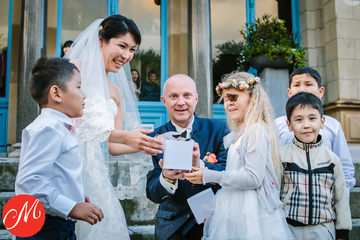 masters_of_dutch_wedding_photography award wedding photo butterfly release landing flower girl eye