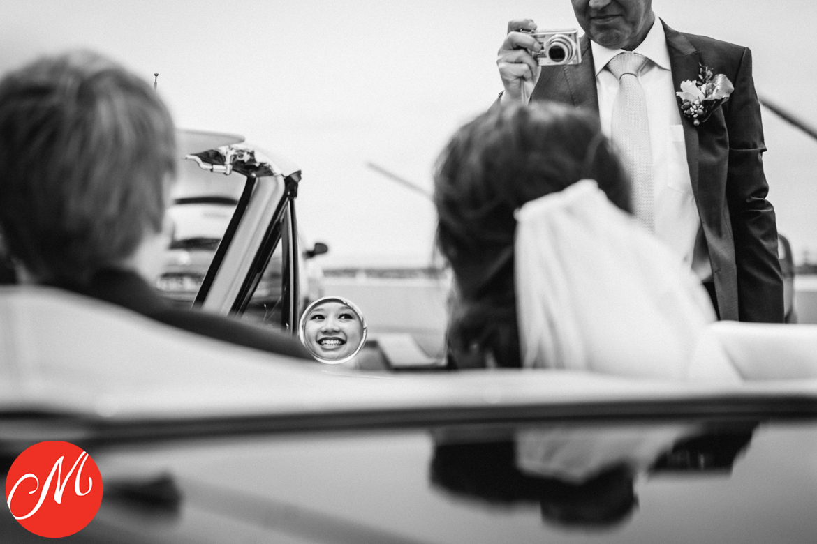 masters_of_wedding_photography_UK award photo bride face mirror reflection uncle_bob taking picture black_white
