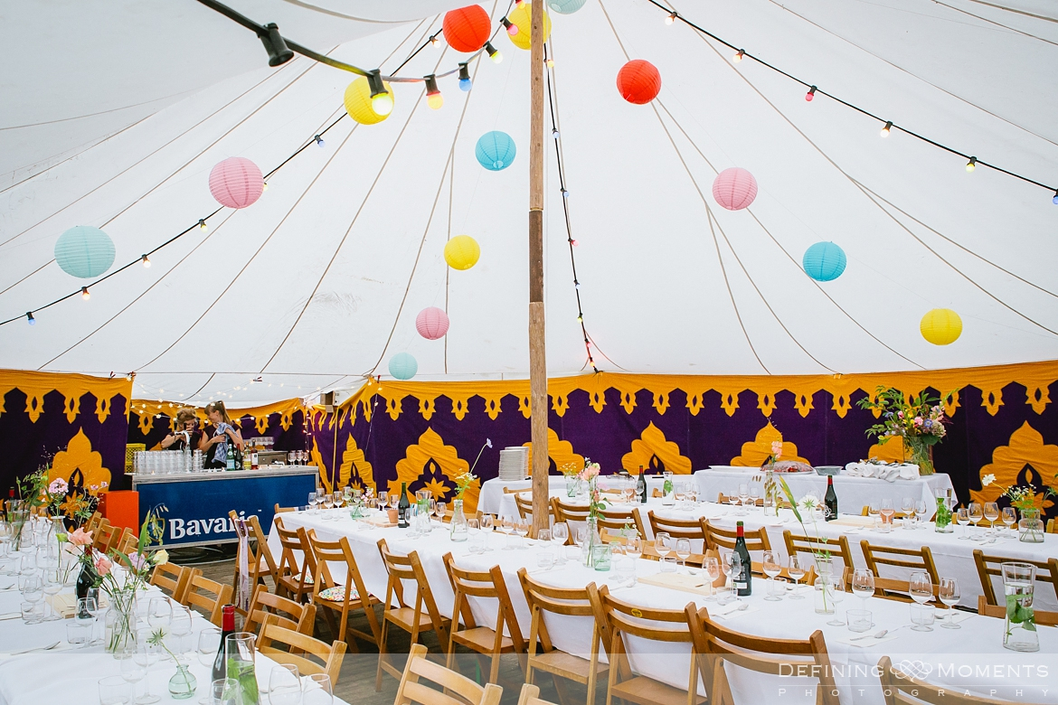 festival wedding venues surrey photographer marquee tipi bohemian photography outdoor ceremony colourful decorations flags lights lantern