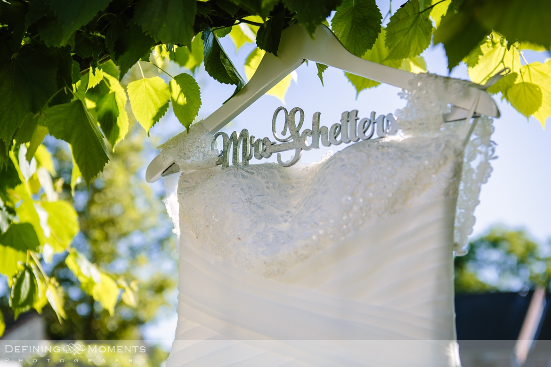 unusual original quirky wedding venue denbies vineyard surrey hills photographer authentic unposed photography outdoor wedding dress hanger name