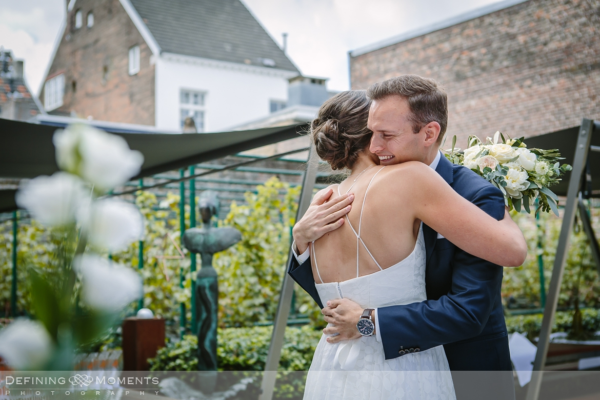 first look bride groom thiessen wine buyers maastricht wine cellar wedding portrait session city centre netherlands