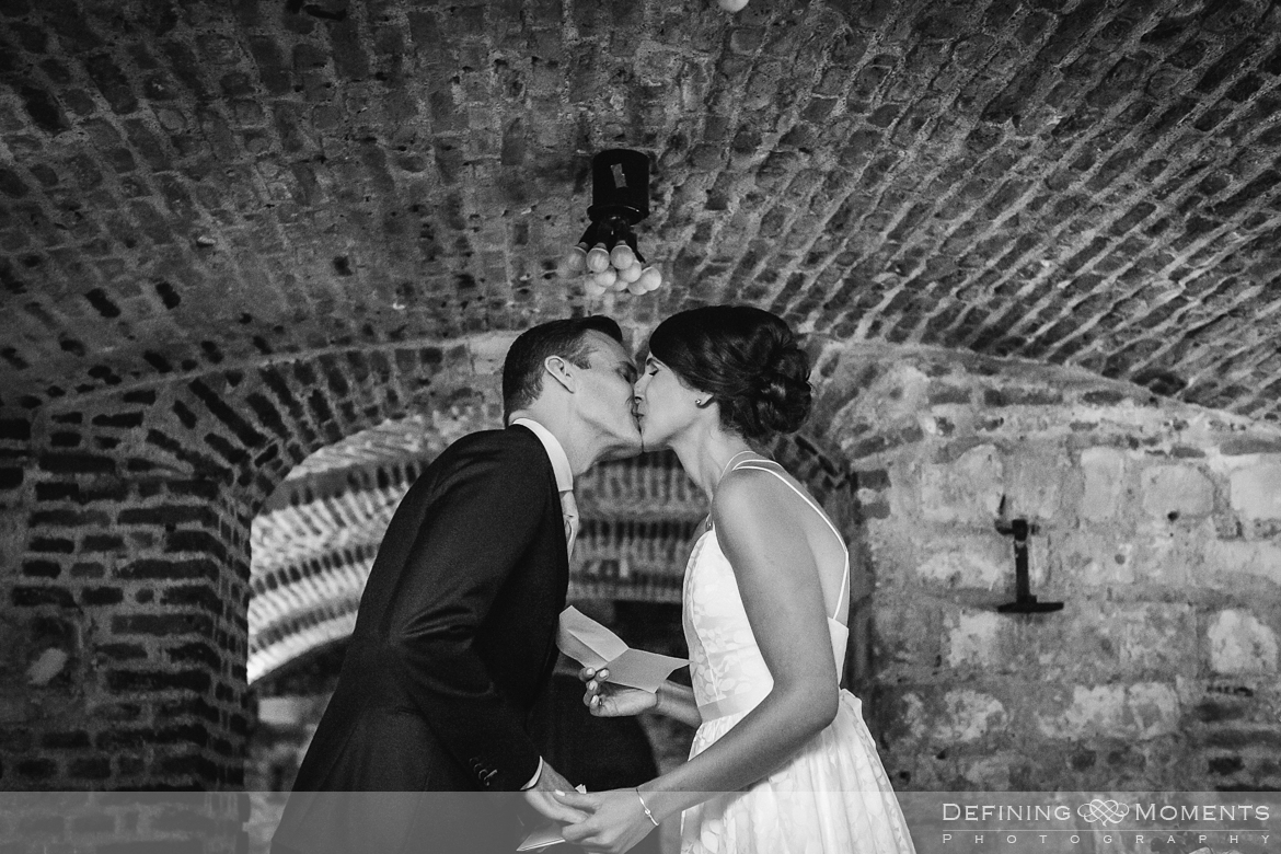 kiss portrait session bride groom maastricht historic picturesque city centre photography wine cellar wedding thiessen wine buyers netherlands