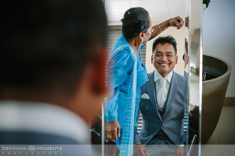 groom_preps industrial wedding venue rotterdam vertrekhal award-winning surrey documentary wedding photographer natural stylish authentic unposed contemporary wedding photography