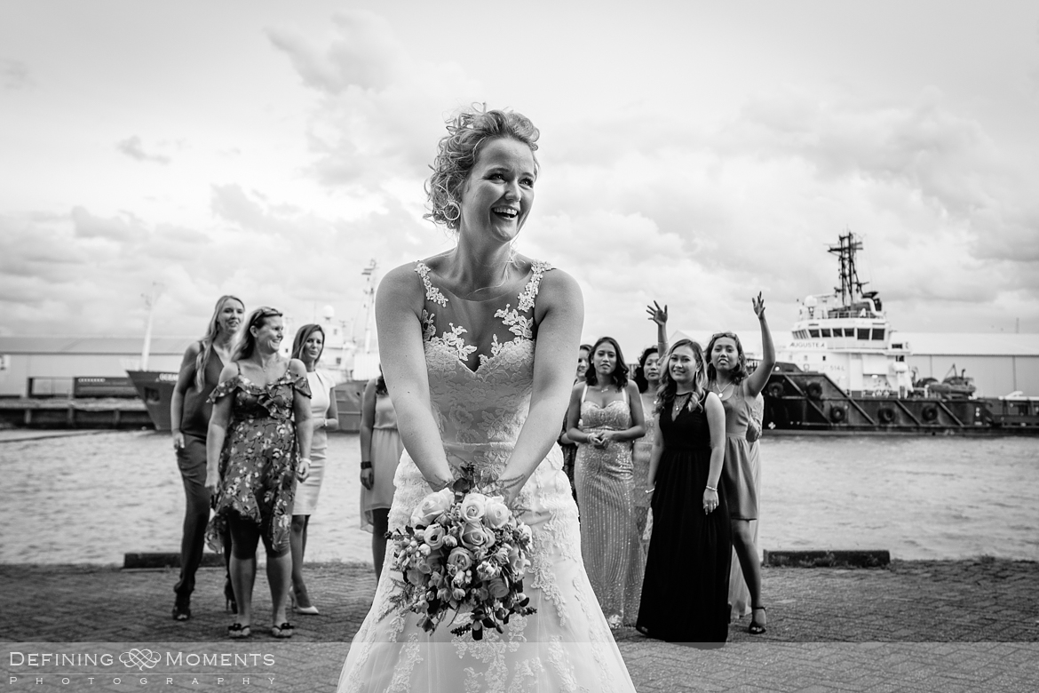 bouquet_toss wedding_portraits  industrial wedding venue rotterdam vertrekhal award-winning surrey documentary wedding photographer natural stylish authentic unposed contemporary wedding photography