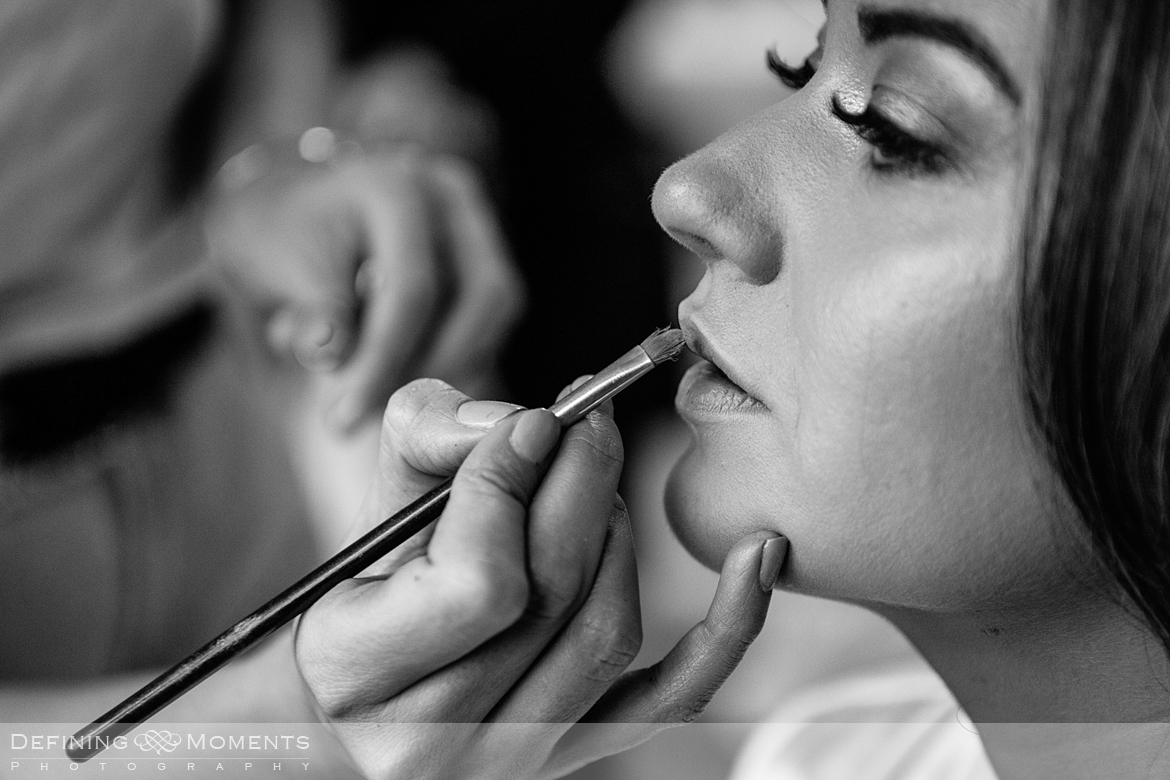 black and white documentary style image of bride getting ready for gildings barn newdigate rustic countryside farm authentic romantic wedding venue venues surrey photographer