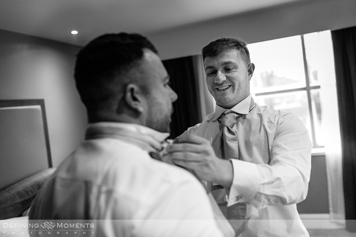 black and white documentary style image groom getting ready for gildings barn newdigate rustic countryside farm authentic romantic wedding venue venues surrey photographer