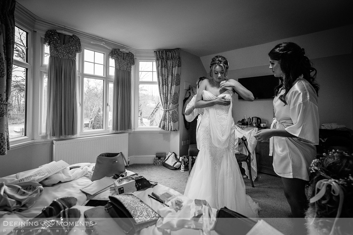 black and white documentary style of bride getting ready for gildings barn newdigate rustic countryside farm authentic romantic wedding venue venues surrey photographer