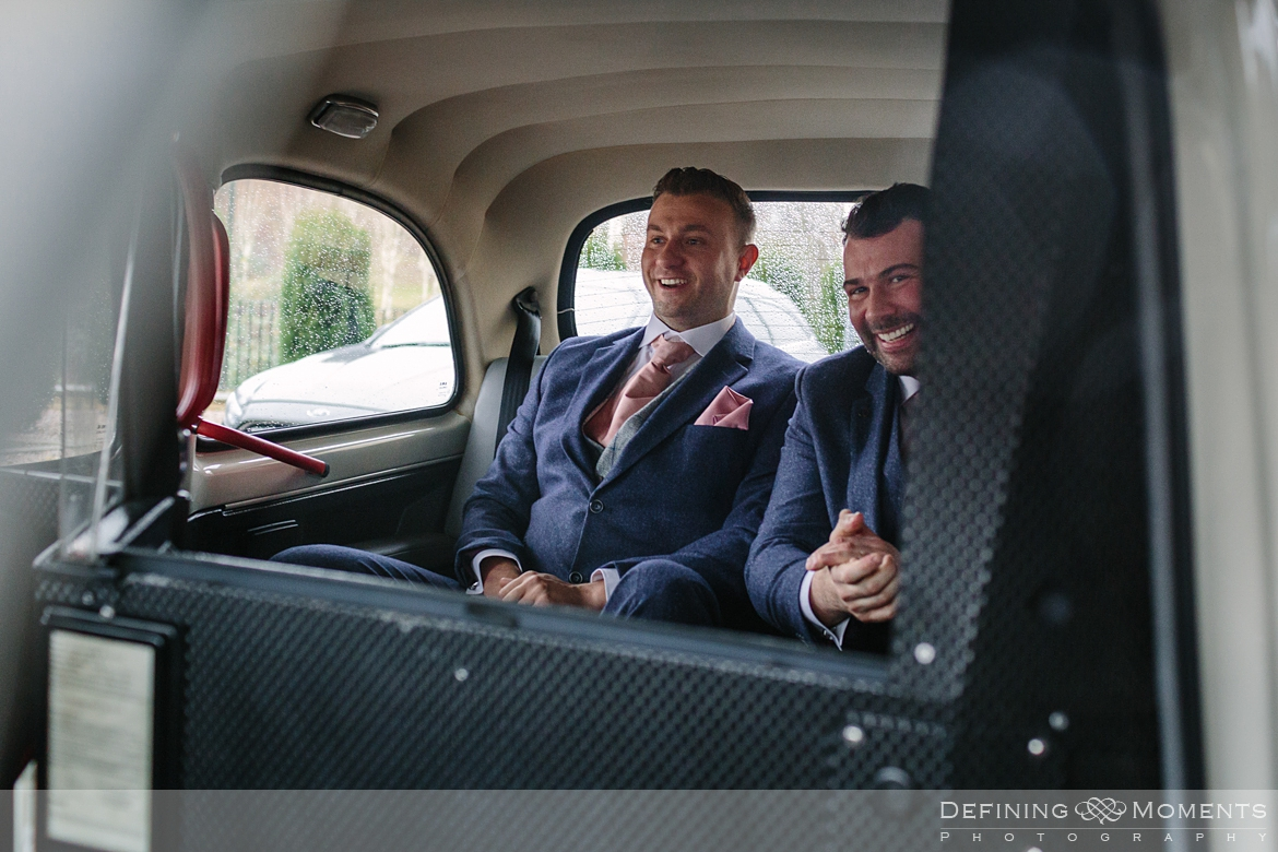 groom and best man in wedding car getting ready for gildings barn newdigate rustic countryside farm authentic romantic wedding