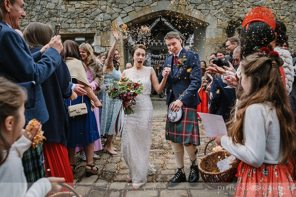 confetti exit bride groom barn wedding ceremony authentic natural unposed journalistic documentary photography wyresdale_park real_moments emotions surrey photojournalistic photographer
