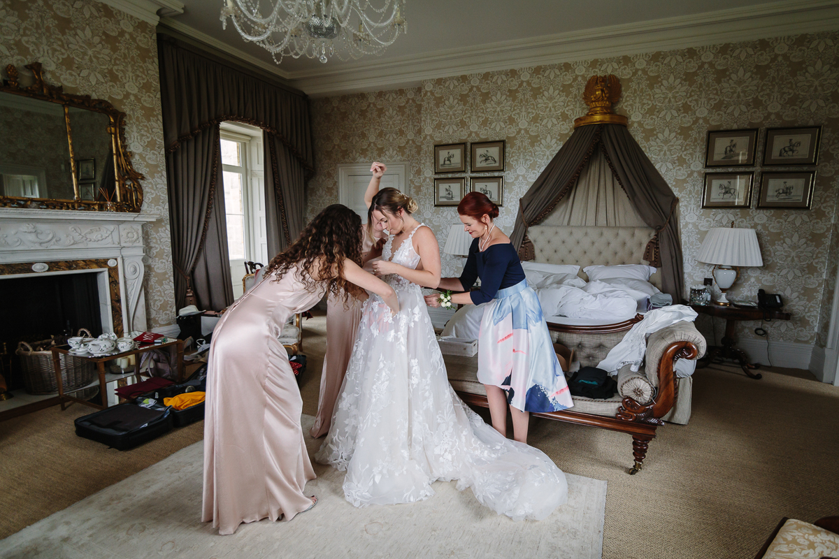 wedding dress cowdray_house bridal_preps diamond_room bridesmaids bride wedding_day real_moments emotions authentic natural unposed documentary journalistic wedding photography west_sussex photographer