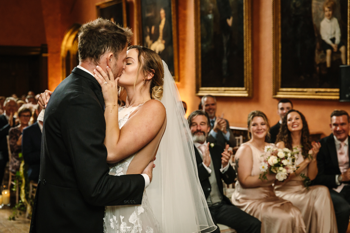 kiss cowdray_house wedding ceremony buck_hall  bride groom getting married real_moments emotions authentic natural unposed documentary journalistic wedding photography west_sussex photographer