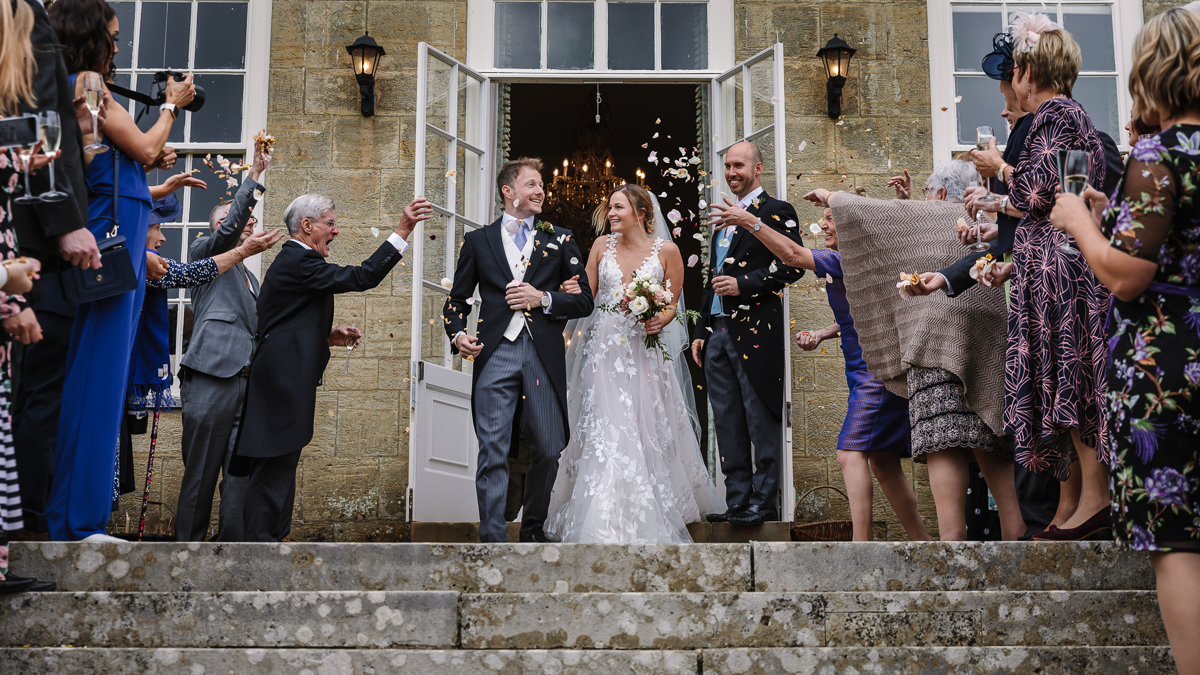 just_married cowdray_house outside terrace wedding reception bride groom wedding photo authentic natural unposed wedding photography west_sussex award_winning photographer