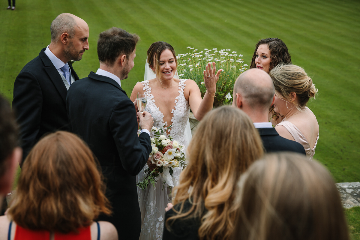 cowdray_house outside terrace wedding reception bride groom wedding photo authentic natural unposed wedding photography west_sussex award_winning photographer