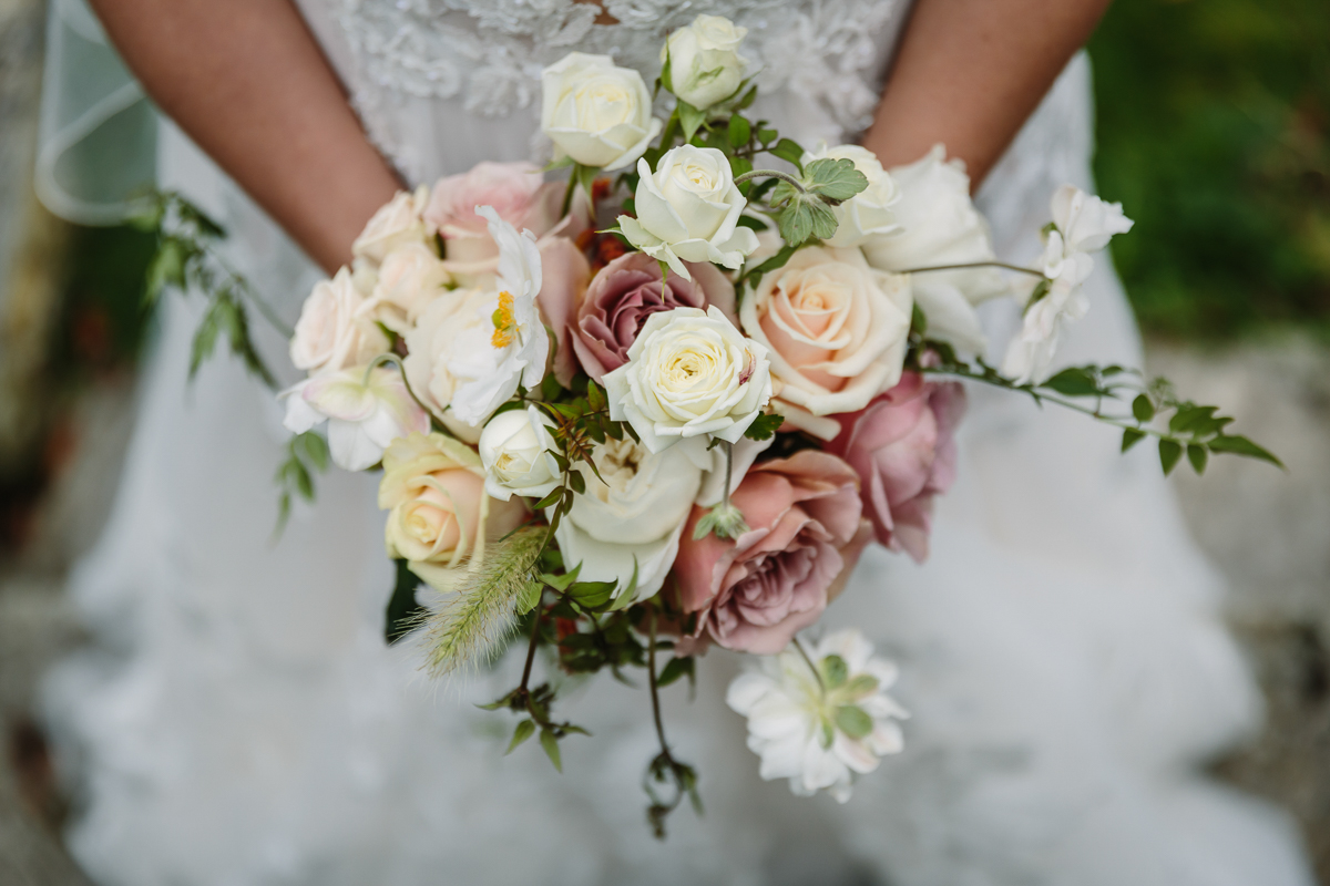 bridal bouquet flowers pastel colours cowdray_house estate bridal portrait session bride groom portraits wedding photo authentic natural unposed wedding photography west_sussex award_winning photographer