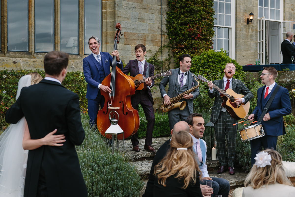 cowdray_house outside terrace wedding reception The_London_Essentials performance performing bride groom country house venue west_sussex award_winning photographer