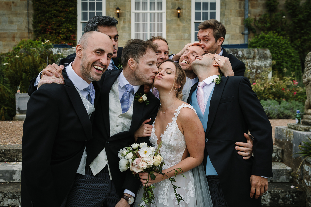 group formals cowdray_house outside terrace wedding reception The_London_Essentials performance performing bride groom country house venue west_sussex award_winning photographer