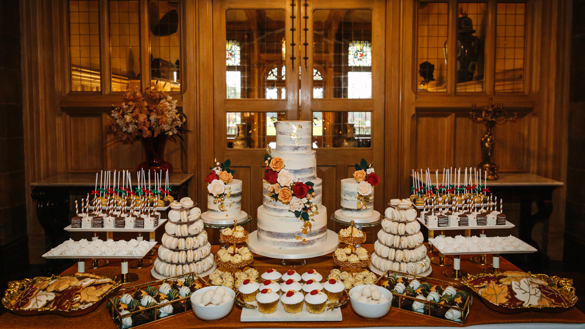 cowdray_house wedding breakfast buck_hall dessert bar wedding cake The_London_Essentials authentic natural unposed wedding photography west_sussex award_winning photographer