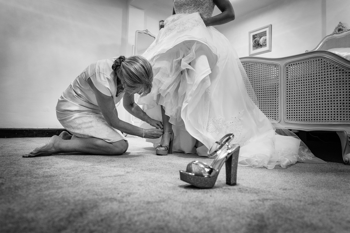 wedding_shoes maidens_barn bridal_preps wedding_dress bridesmaids bride wedding_day real_moments emotions authentic natural unposed documentary journalistic wedding photography essex photographer
