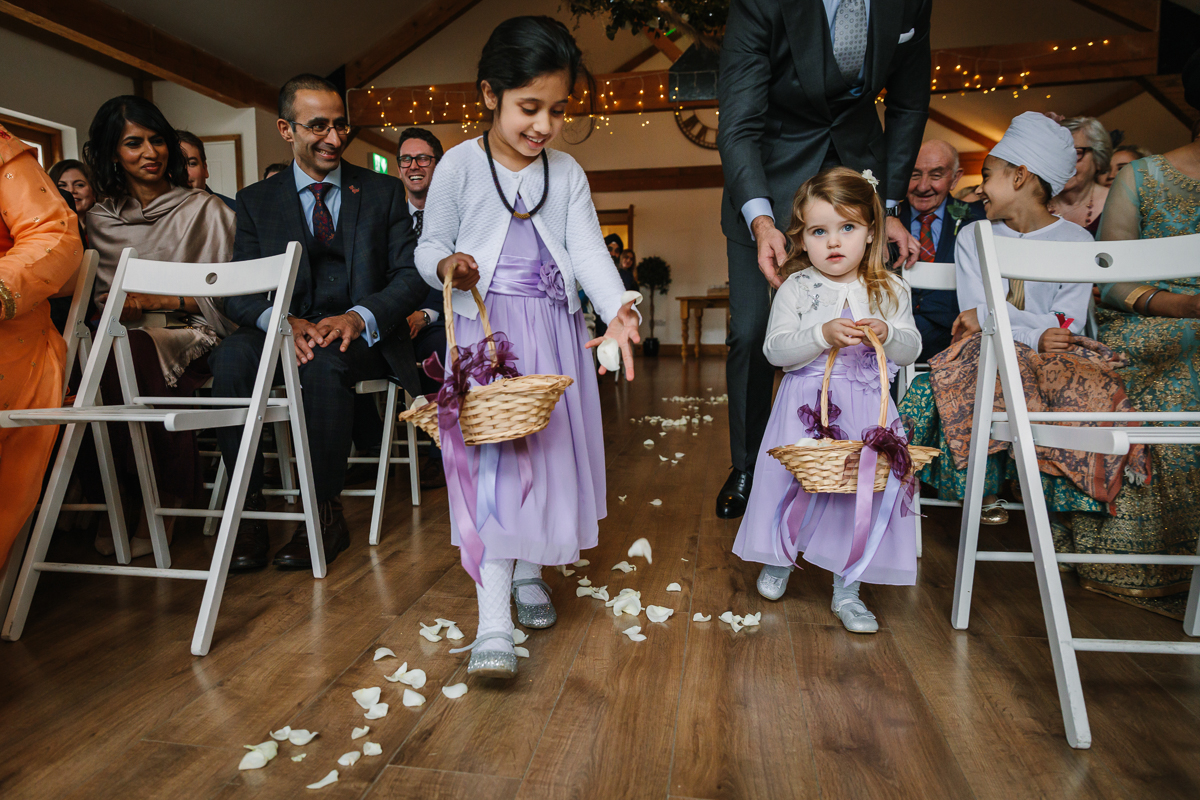 flower_girls maidens_barn wedding ceremony oak_barn bride groom getting married real_moments emotions authentic natural unposed documentary journalistic wedding photography west_sussex photographer