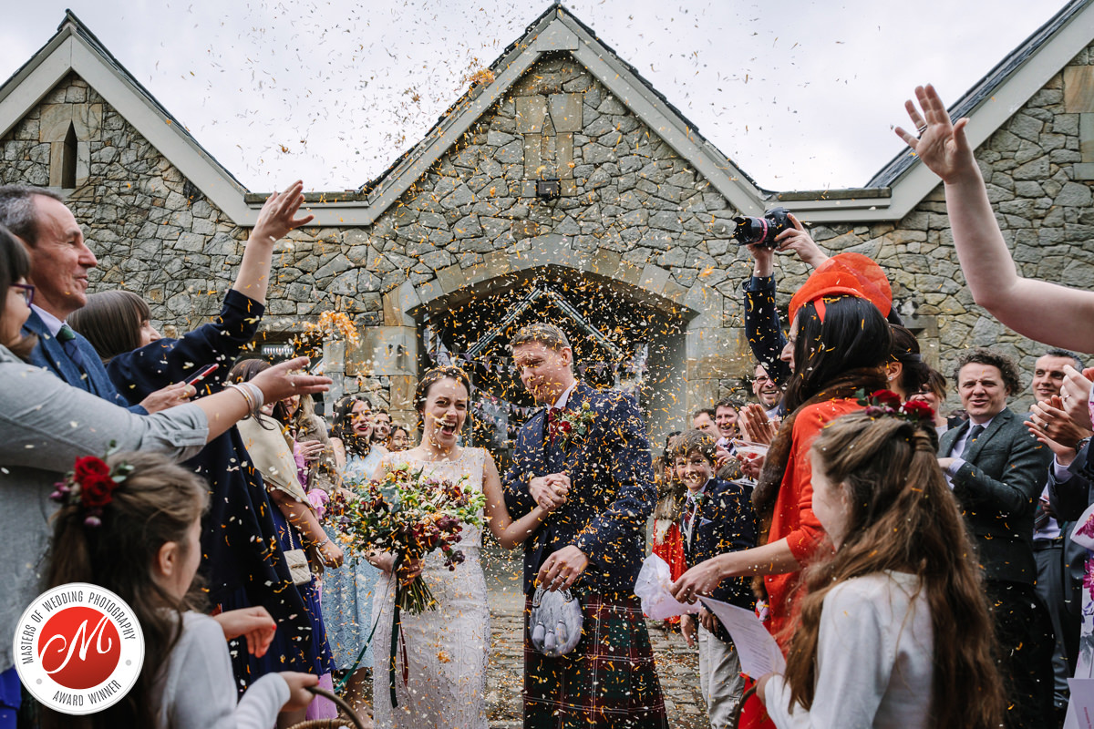 flower petals bride groom exit confetti wedding photo flower wedding_day real_moments emotions authentic natural unposed documentary journalistic wedding photography surrey photographer
