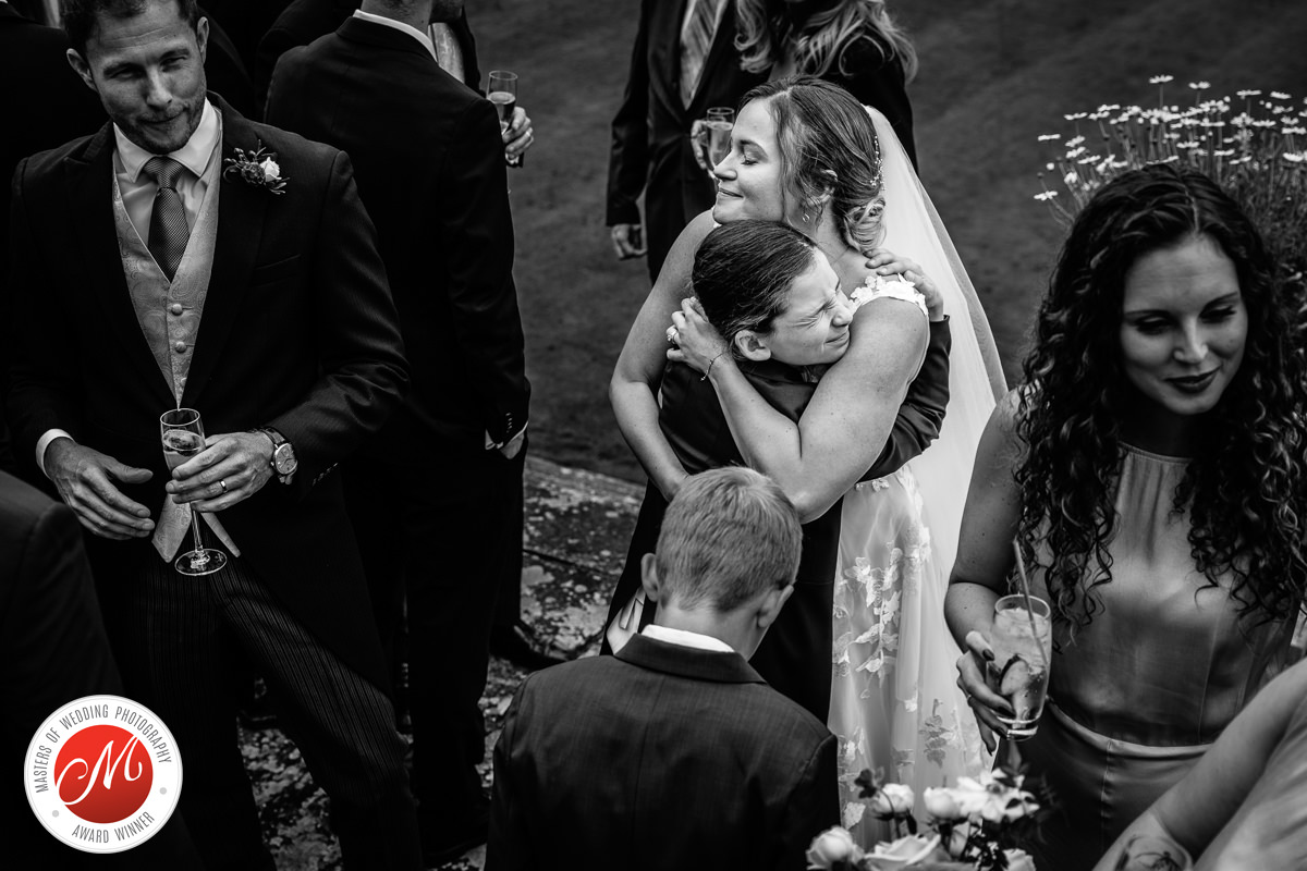 bride embrace black_white cowdray_house outside terrace wedding reception bride groom country_house venue west_sussex award_winning photographer documentary wedding photography photo