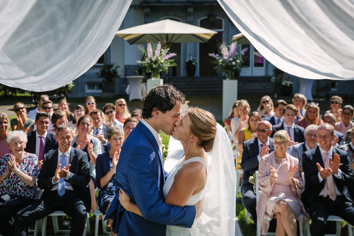 wedding ceremony kiss bride groom sunny sunlight photo journalistic documentary reportage photographer photo surrey