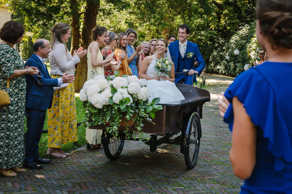 bride groom arrival in cargo bike at wedding ceremony photo journalistic documentary reportage photographer photo surrey