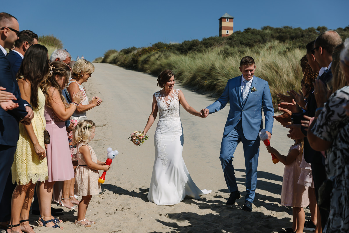 bride groom arrive hand in hand at beach wedding wedding photo journalistic documentary reportage photographer photo surrey