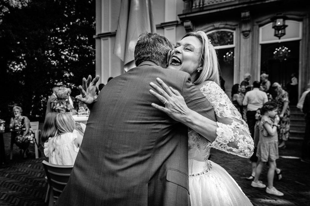 bride embraces wedding guest black_white wedding photo journalistic documentary reportage photographer photo surrey