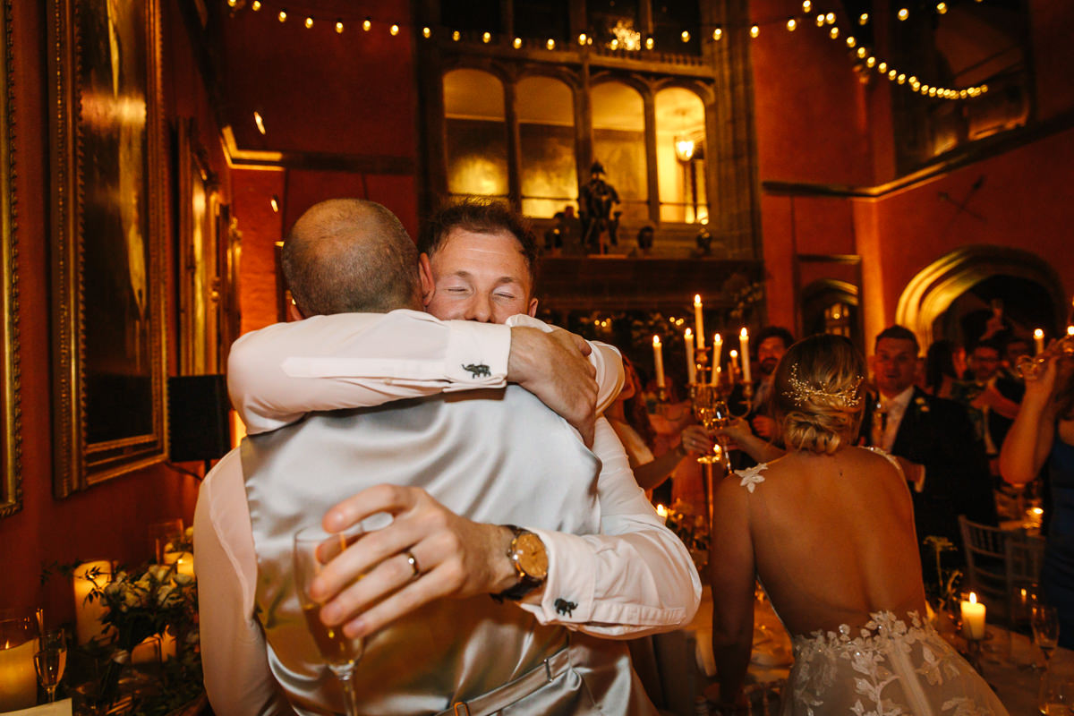 groom embrace best man during wedding breakfast buck_hall cowdray_house wedding photo journalistic documentary reportage photographer photo surrey