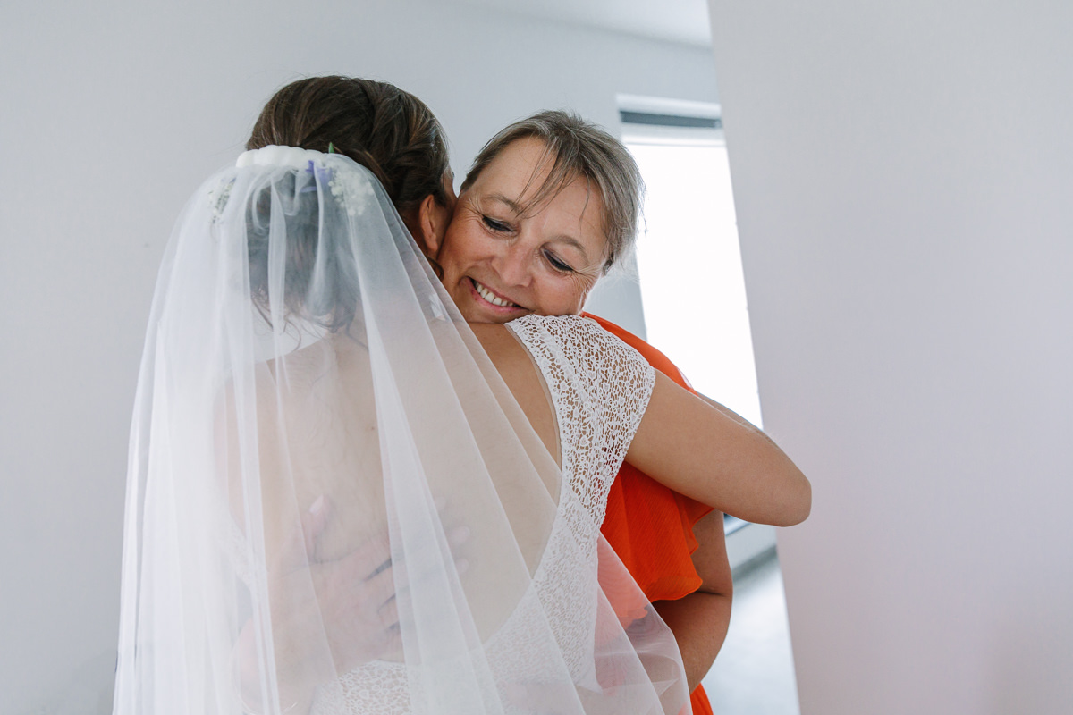bride embrace embracing mother wedding day wedding photo journalistic documentary reportage photographer photo surrey