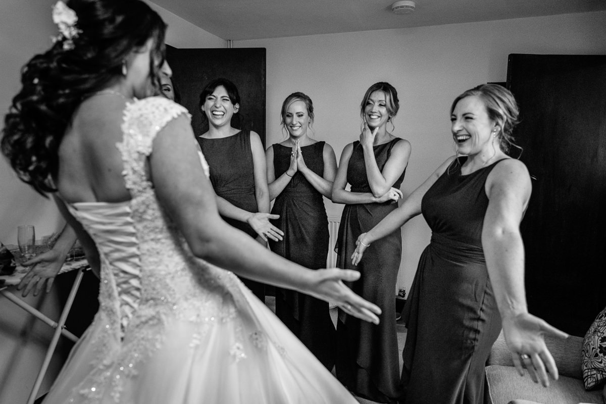 bridesmaids smiling at bride wedding photo journalistic documentary reportage photographer photo surrey