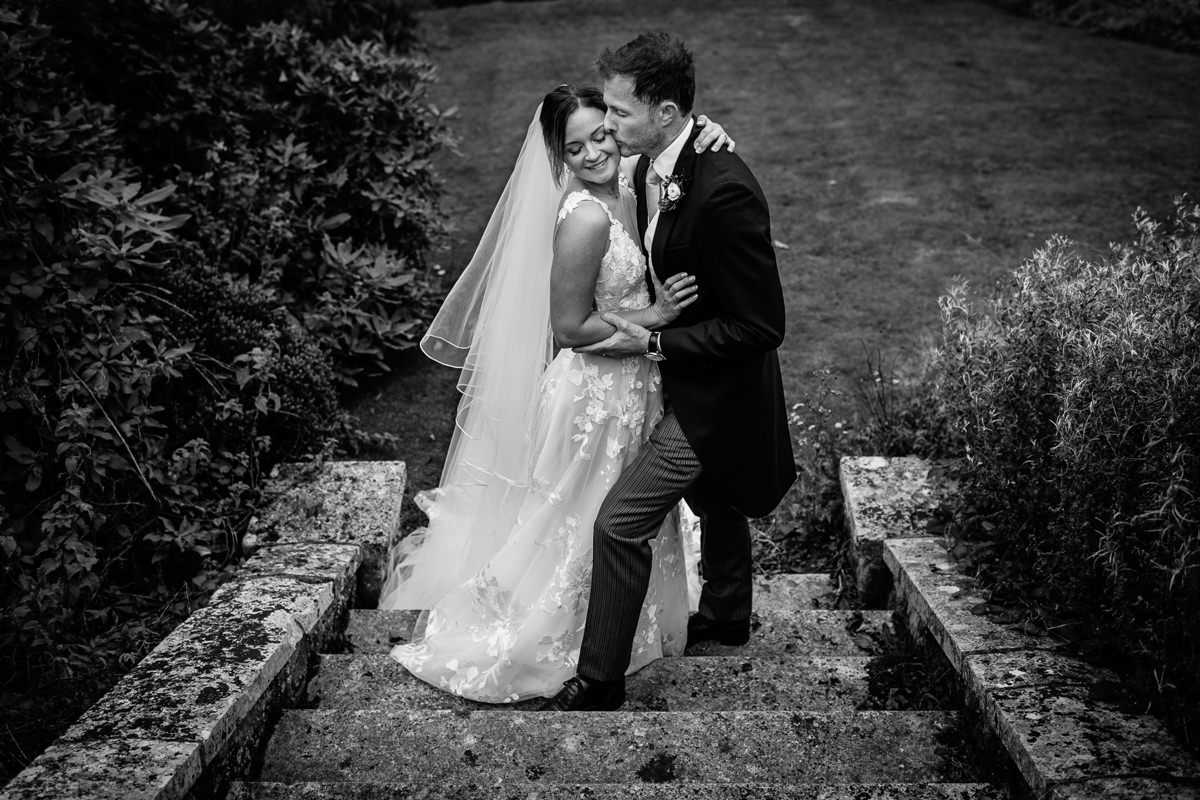 bride groom black_white portrait outside outdoor steps stairs cowdray_house journalistic documentary reportage photographer photography photo surrey