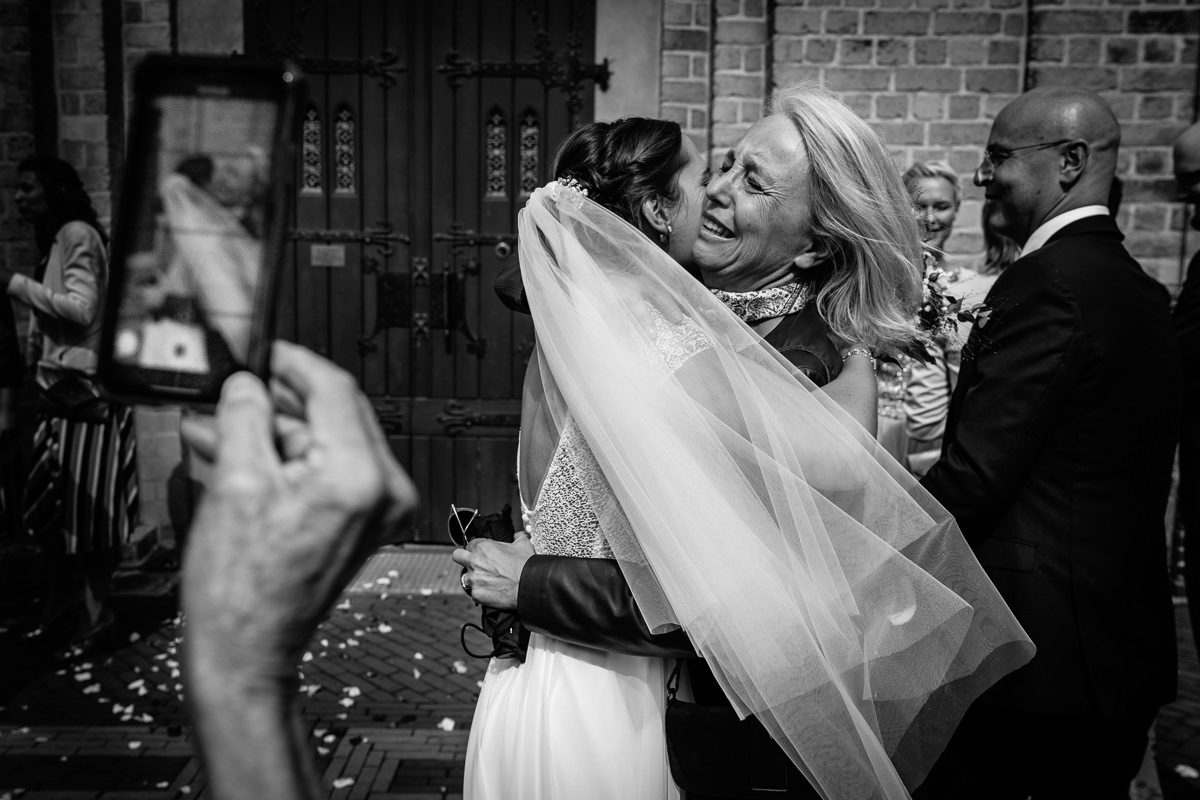 bride embrace church wedding black_white journalistic documentary reportage photographer photography photo surrey