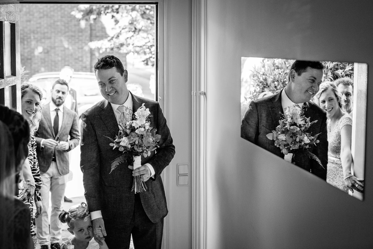 groom bouquet front door first look journalistic documentary reportage photographer photography photo surrey