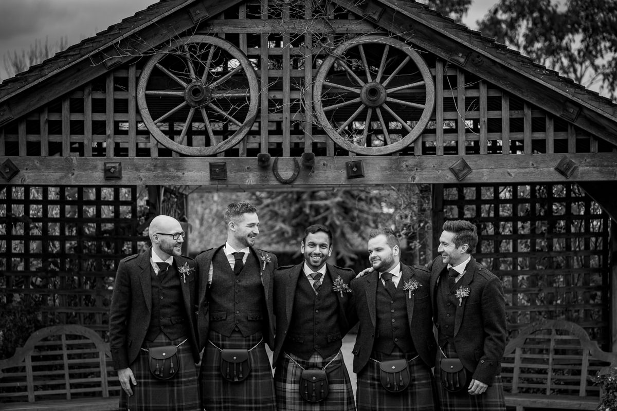 groom and groomsemen best man portrait maidens barn outside outdoor journalistic documentary reportage photographer photography photo surrey