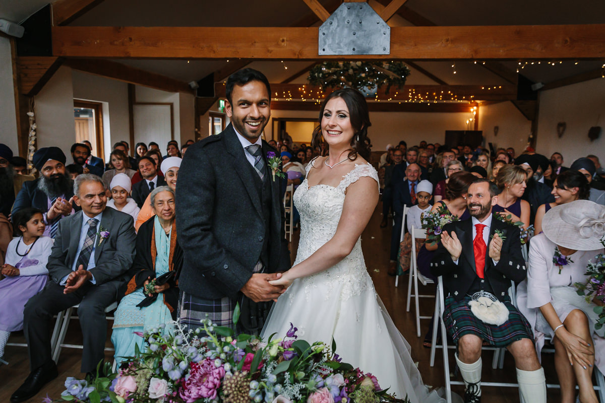 maidens barn wedding ceremony say yes tie the knot wedding couple multicultural wedding journalistic documentary reportage photographer photography photo surrey
