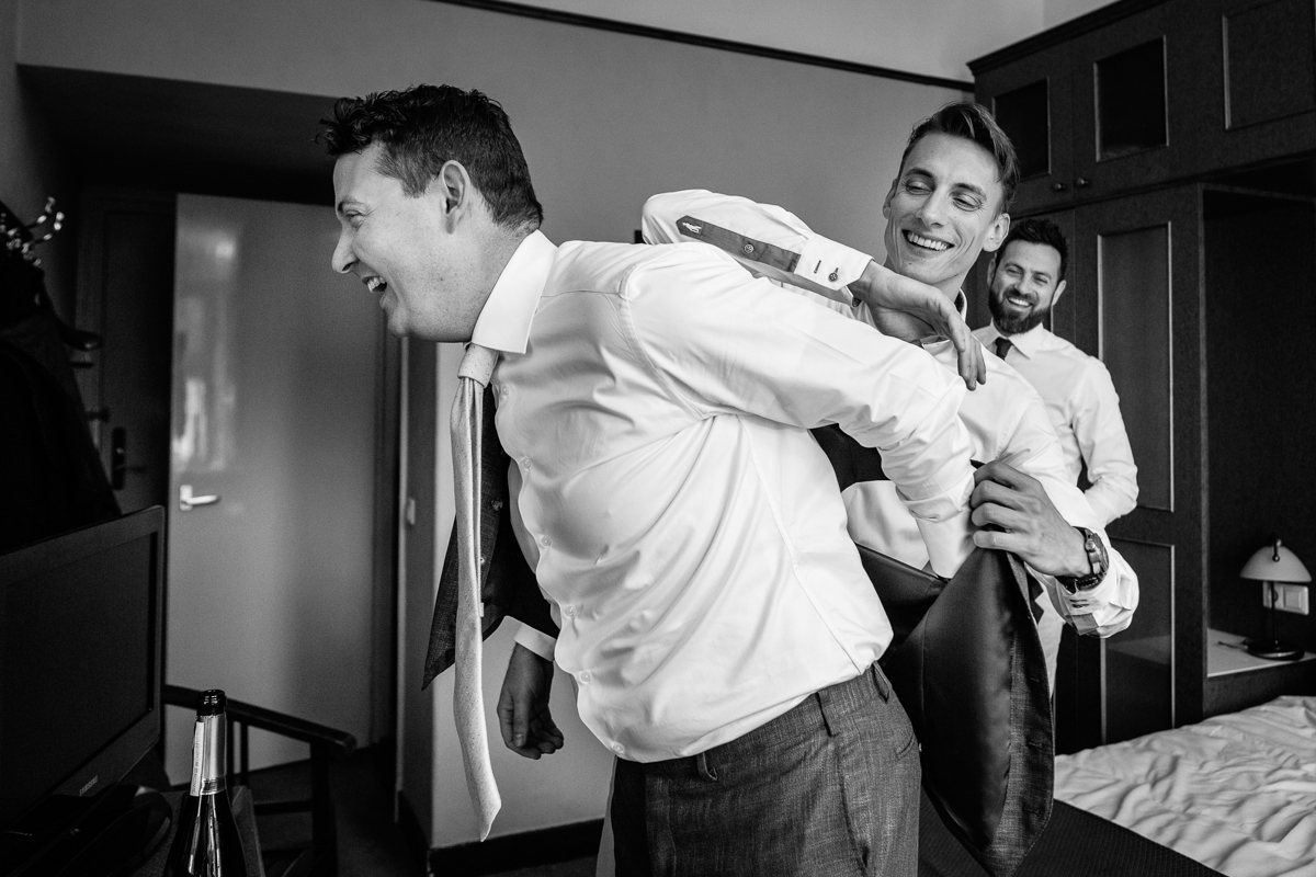 groom prep getting ready wedding day black_white