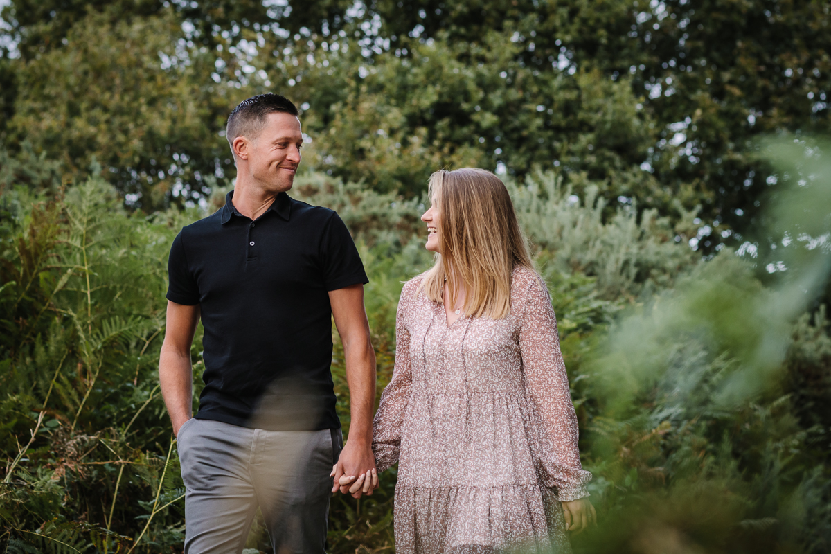 natural authentic image couple walking headily heath surrey hills twirl unposed engagement session outdoor pre-wedding_shoot natural light documentary wedding photographer