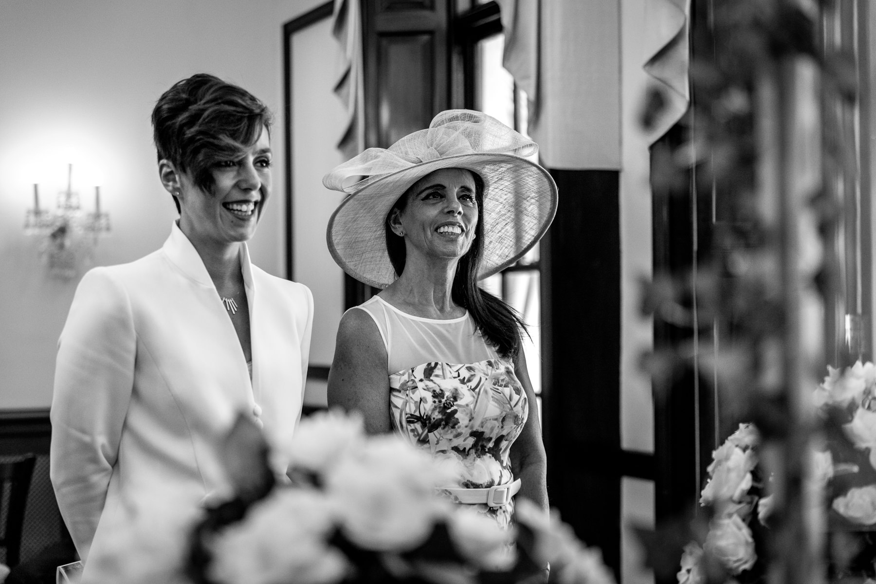 wedding ceremony black_and_white image mother ot bride natural authentic documentary wedding photo bride groom couple beaverbrook surrey hills leatherhead register office wedding photographer