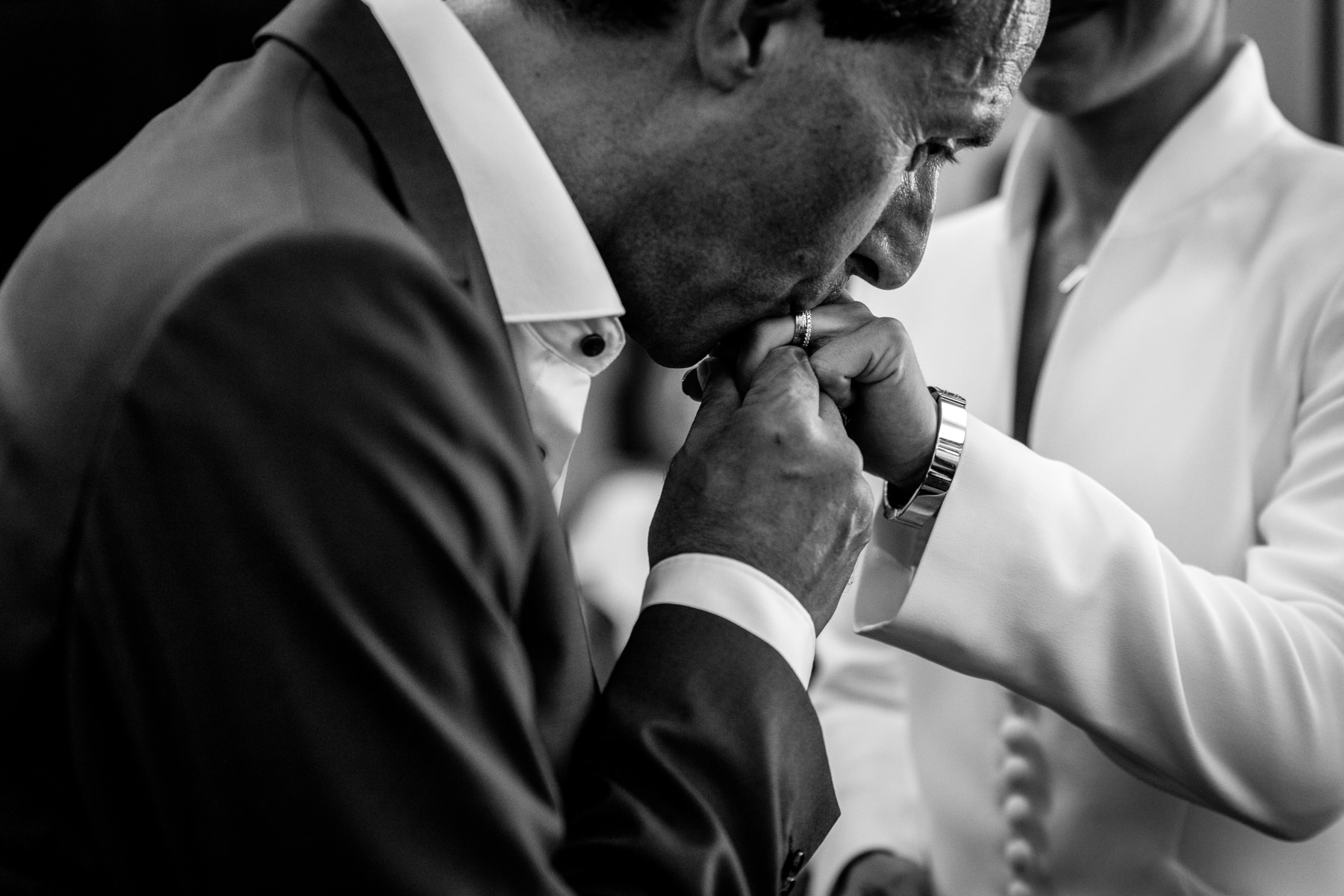 groom kissing bride hand wedding ring black&white image natural authentic documentary wedding photo bride groom couple beaverbrook surrey hills leatherhead register office wedding photographer