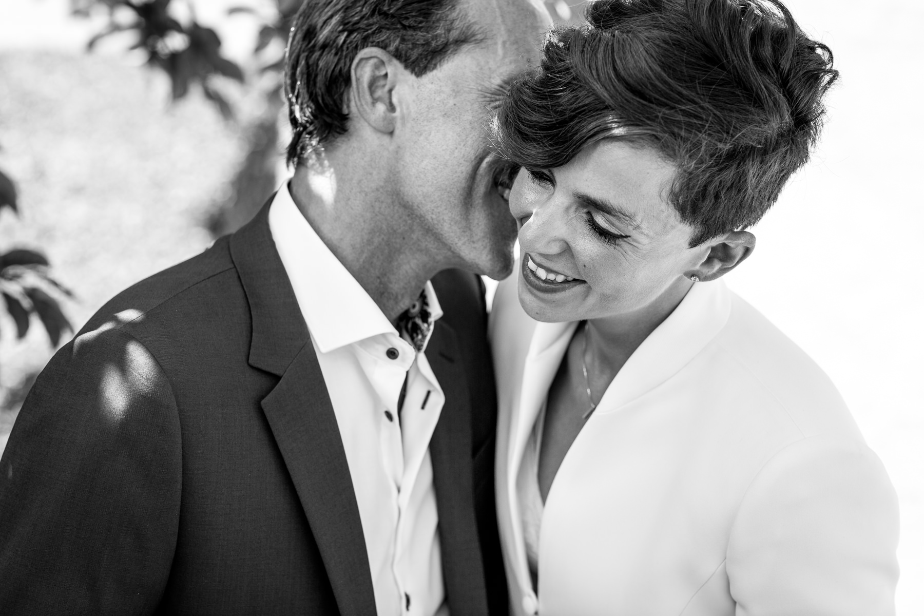 bride groom close-up portrait black&white image smiling embrace natural authentic documentary wedding photo bride groom couple beaverbrook surrey hills leatherhead register office wedding photographer