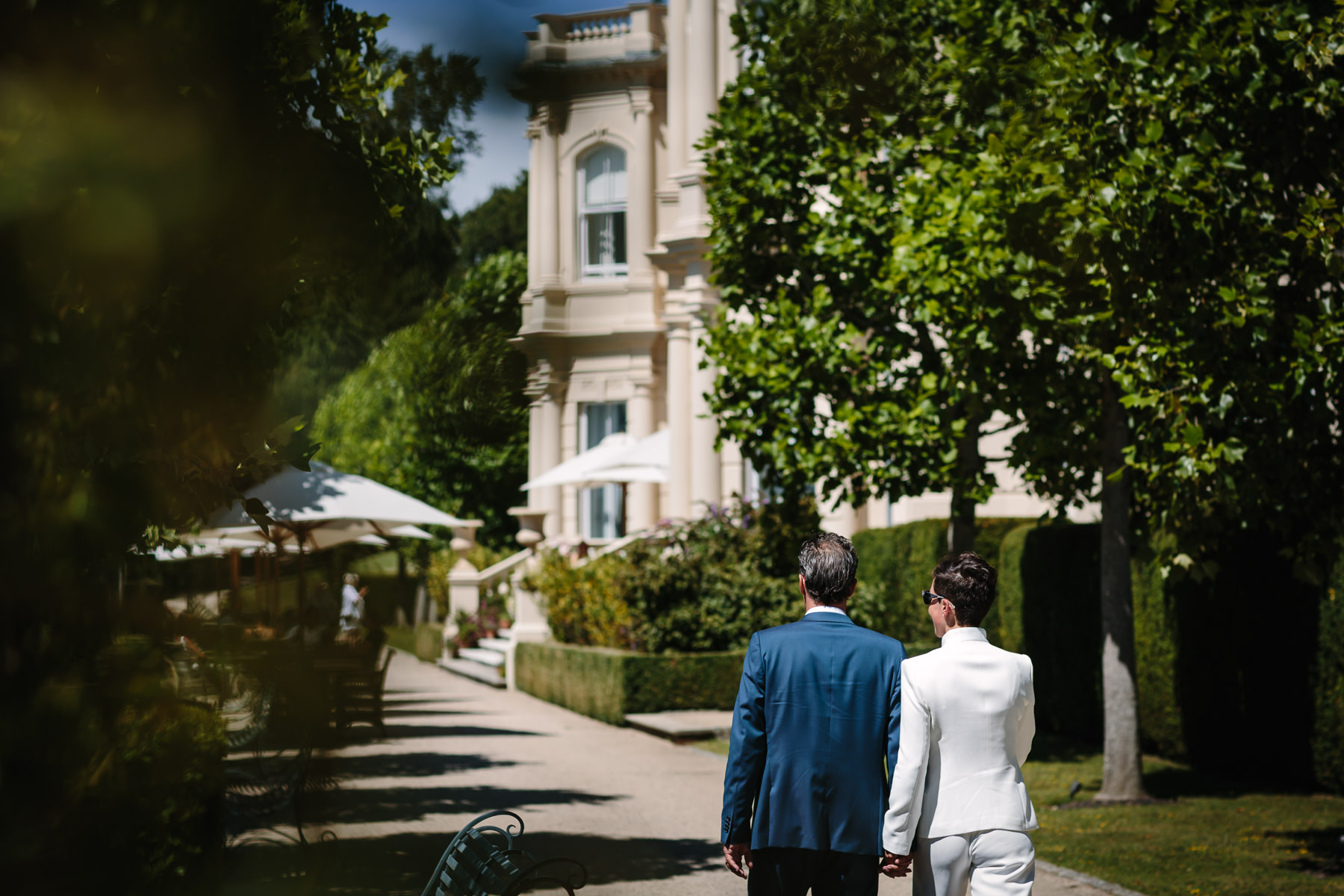 bride groom walking rear view colour image beaverbrook garden natural authentic documentary wedding photo bride groom couple beaverbrook surrey hills leatherhead register office wedding photographer